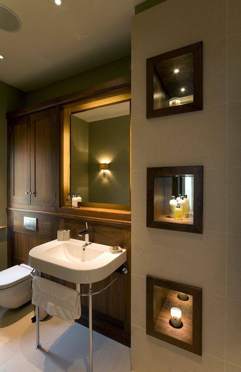 Darl colored bathroom with back lighting of the mirror