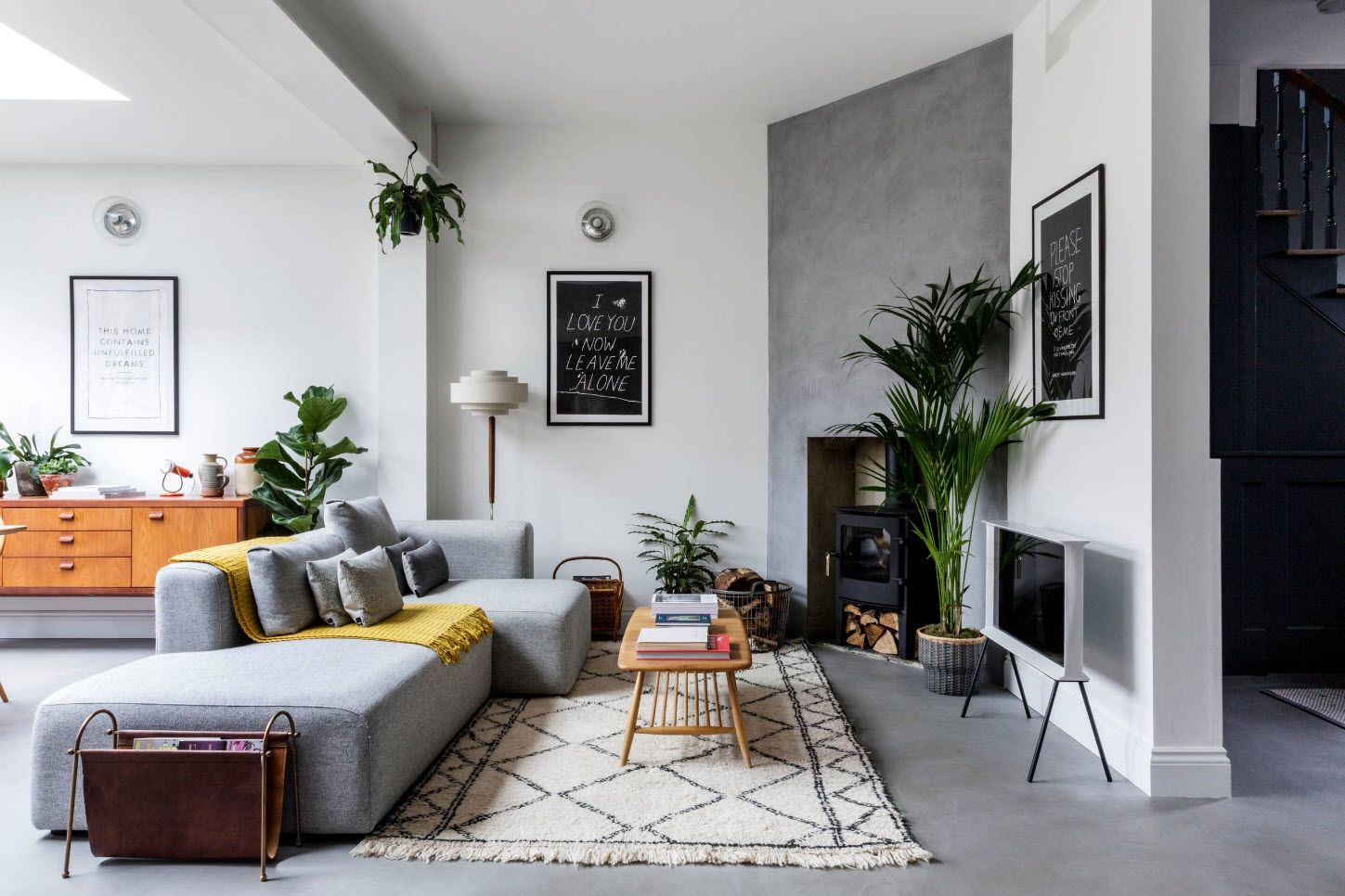 Gray intterior decoraion with carpet and upholstered sofa