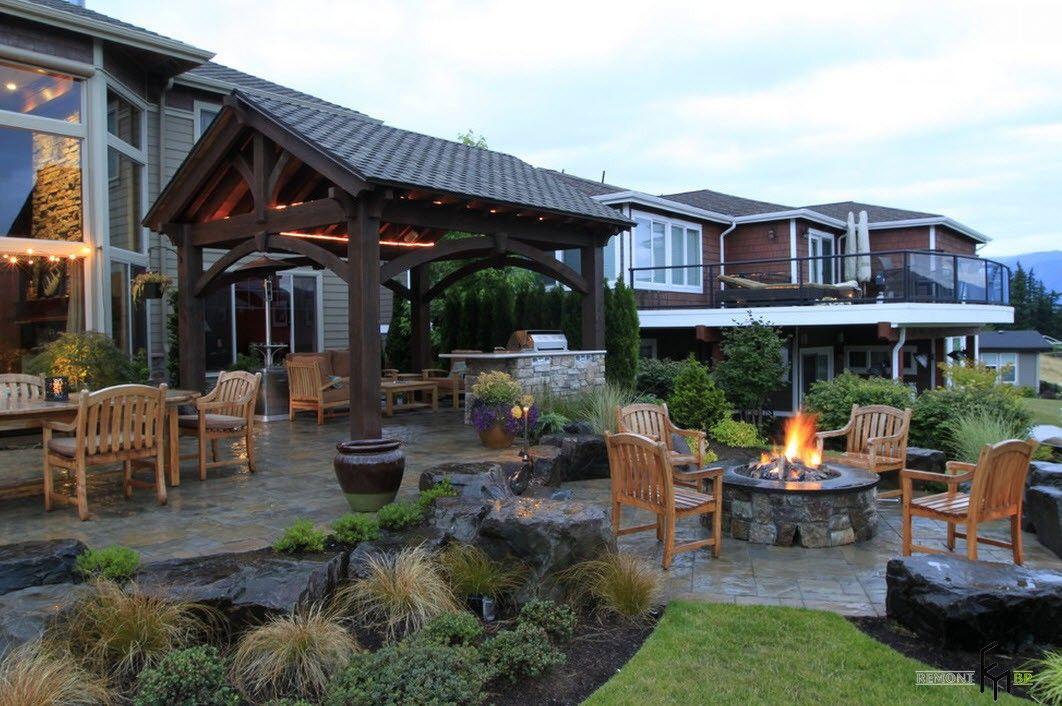 Backyard and Garden Gazebo: Design, Form, Use and Practical Advice. Dark wooden gazebo