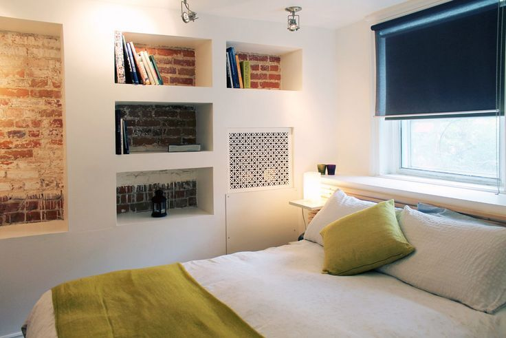 Niche in the Room: Recess in the Wall for Decoration and Functionality. Shelves in the built-in construction of the modern bedroom