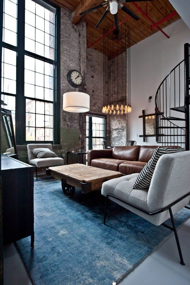 Business negotiation zone in the open space living room with high ceilings and beige color theme