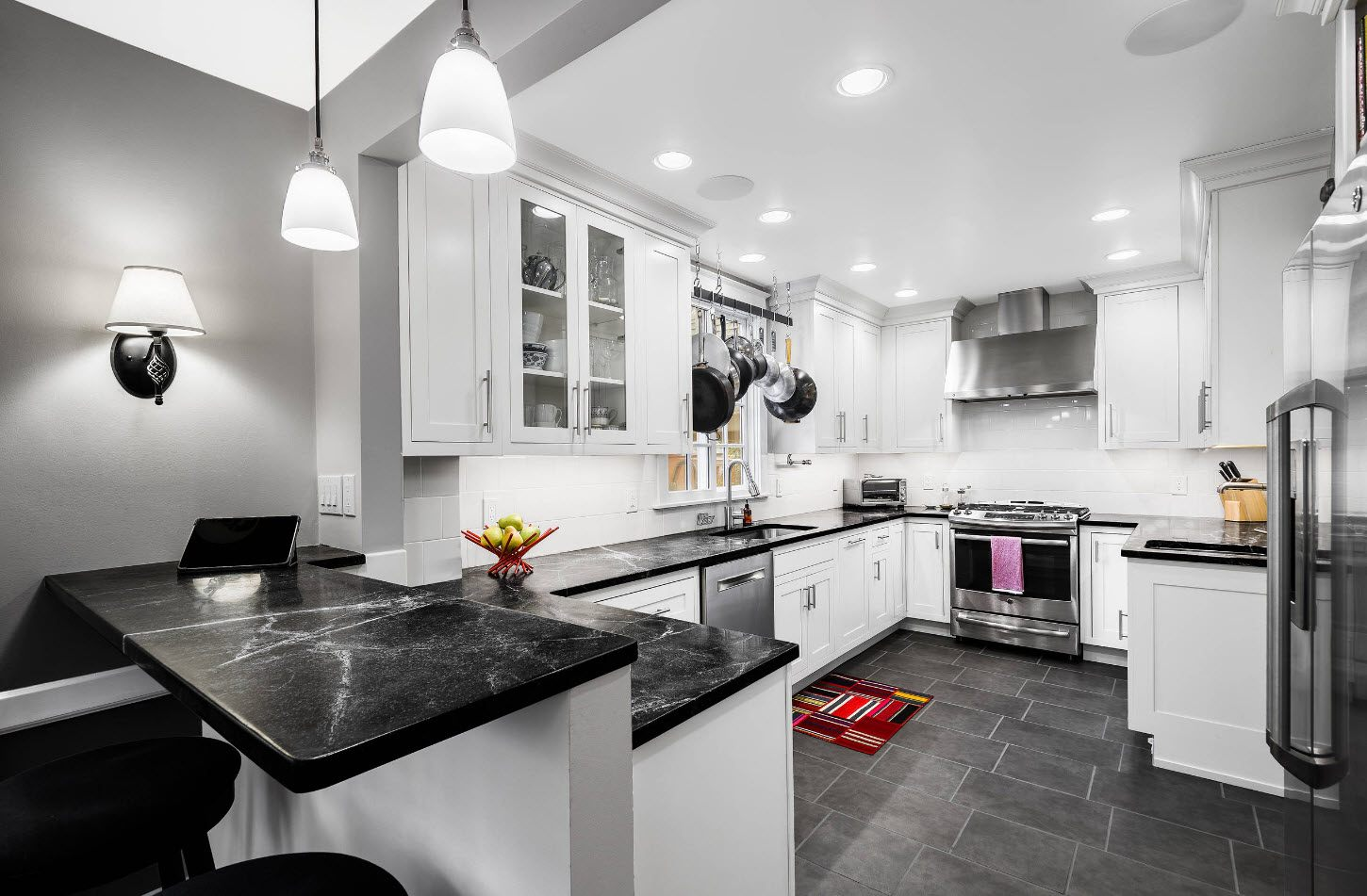 White classic large kitchen with dark tiled floor