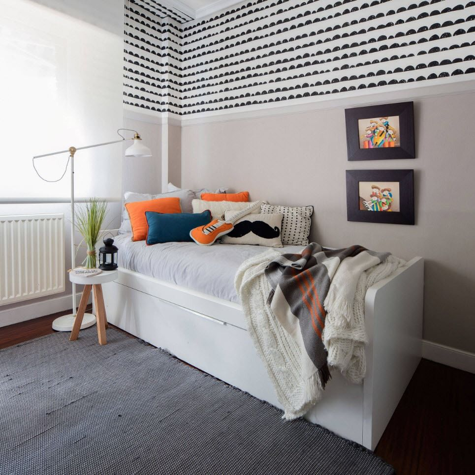 Black and White Wallpaper: Ageless Classics in any Interior. Kids' room with bright accents on the bed and dotted wall decoration