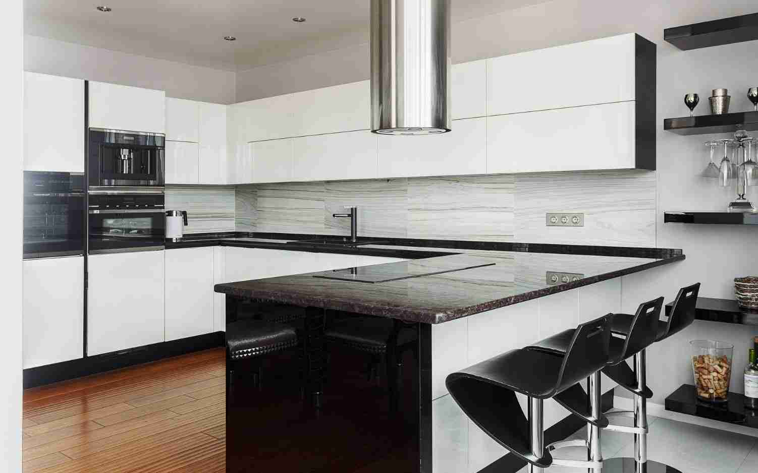 160 Square Feet Kitchen Design Ideas. Black glossy plastic coating for modern high-tech kitchen with round steel extractor