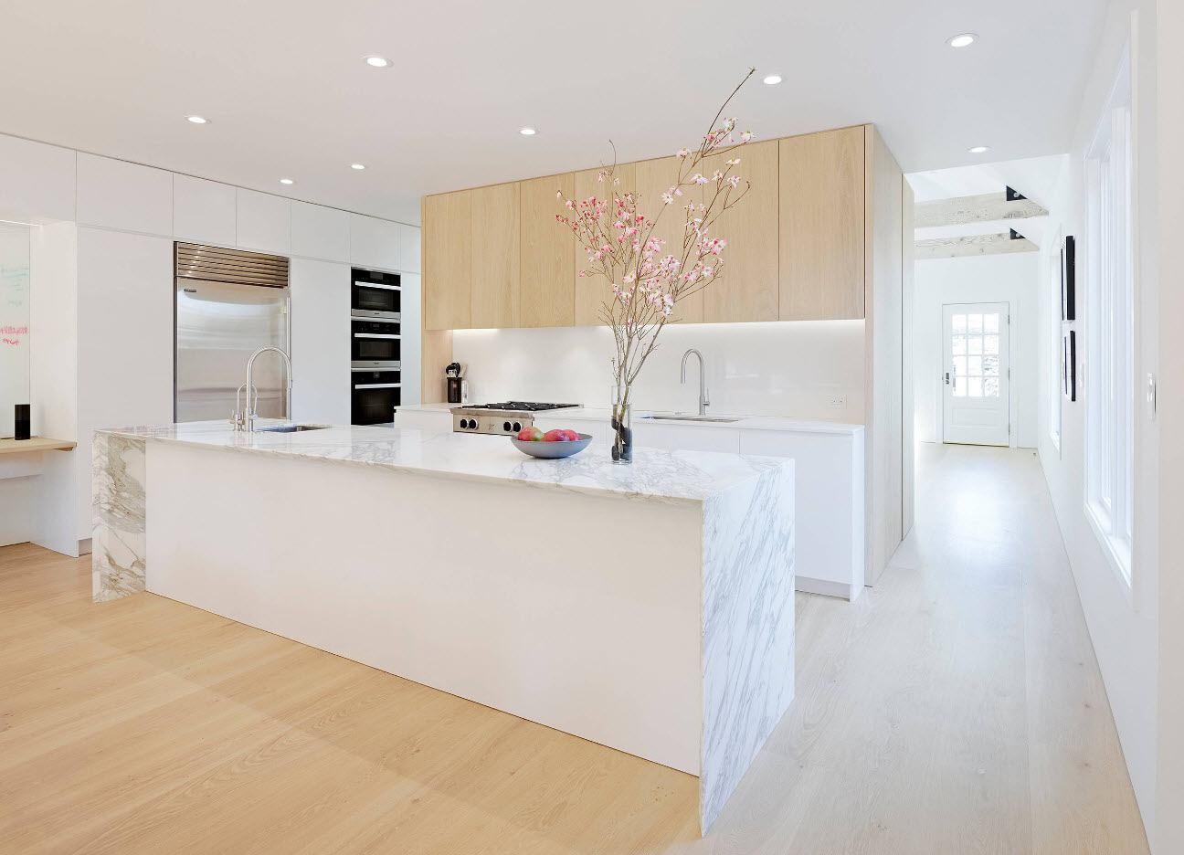 160 Square Feet Kitchen Design Ideas. Light wooden laminate on the floor and white kitchen island