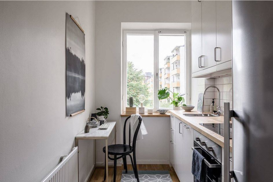 Best Ideas on Tables and Chairs for Small Kitchen. Modern galley kitchen in light tones with small wall table for one