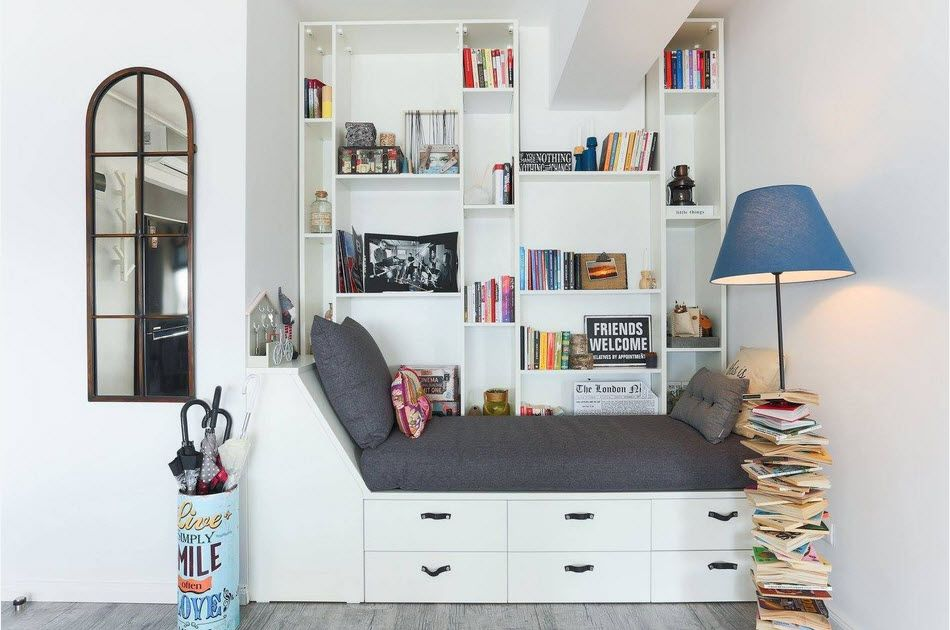 Children's room with alternative design of the bed full of the storage for things and books