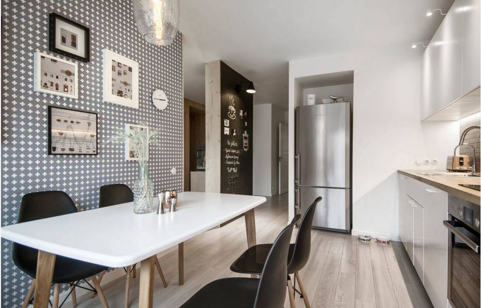 Dining room with dotted colored wall and white glossy table