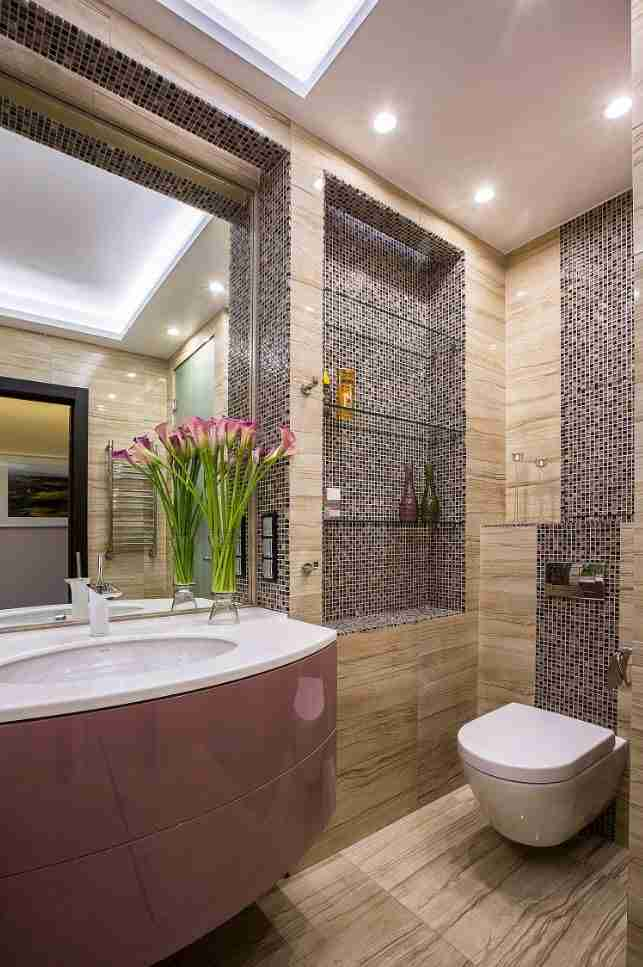 Bathroom Shelves: Fashionable Trends of Practical Interior Decoration. Mosaic trimmed beige, gray and brown interior of the bathroom with glass shelves