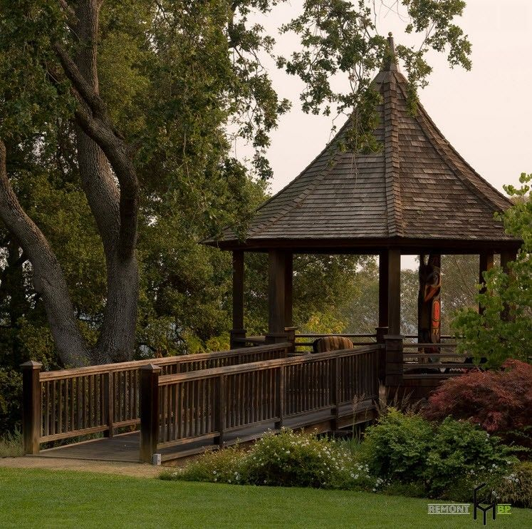 Backyard and Garden Gazebo: Design, Form, Use and Practical Advice. Big pavilion in Eastern style with a bridge