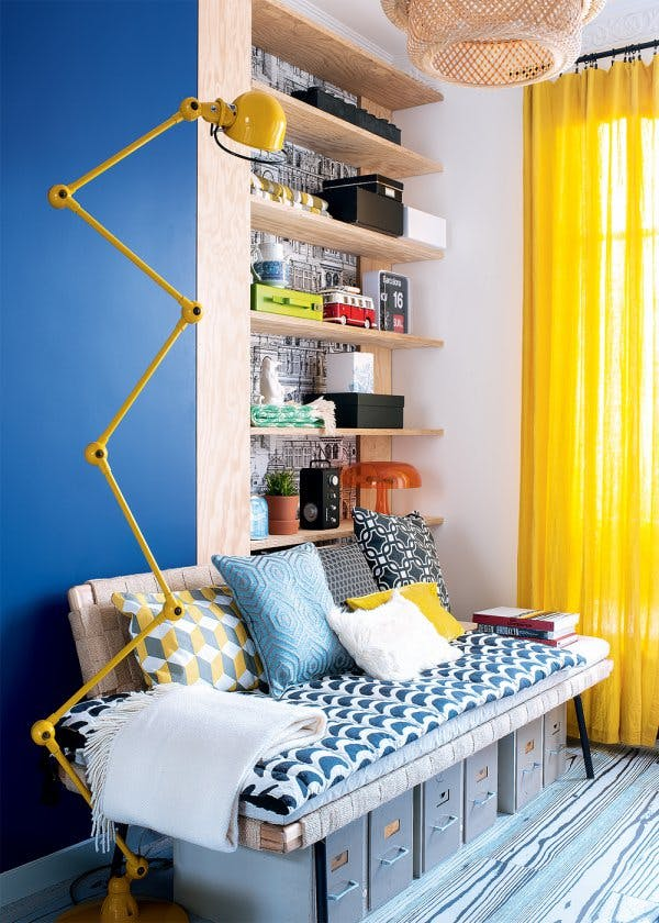 Unusual segmentary lamp and yellow curtains in the modern designed living