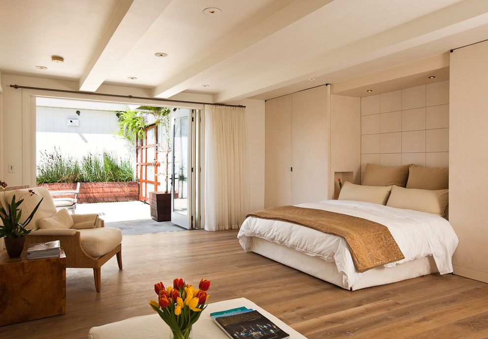Beige interior of the open spaced bedroom in modern styled with differebt level ceiling