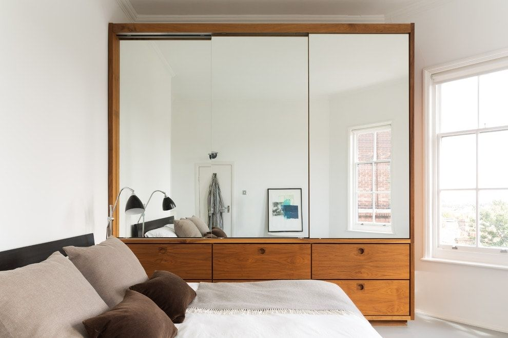 Mirror in the wooden closet for small bedroom