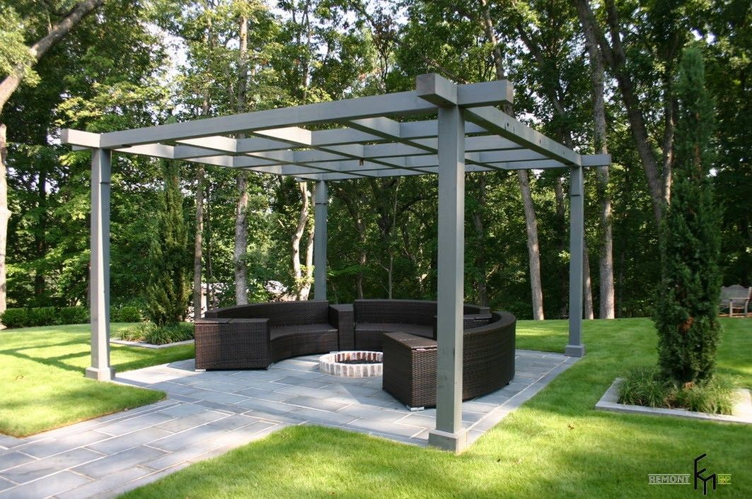 Dark gray framed canopy at the summer house backyard