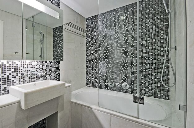 Choosing Ceramic Tile for Small Bathroom. Black and white mosaic for the modern designed space with glass