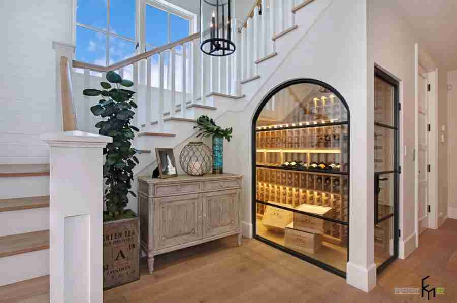 Improvised wine cellar right under the stairs