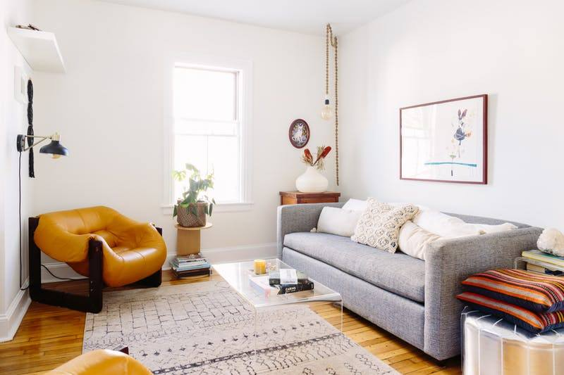 130 Square Feet Living Room most Effective Design Ideas. Light minimalistic room with yellow armchair and a carpet