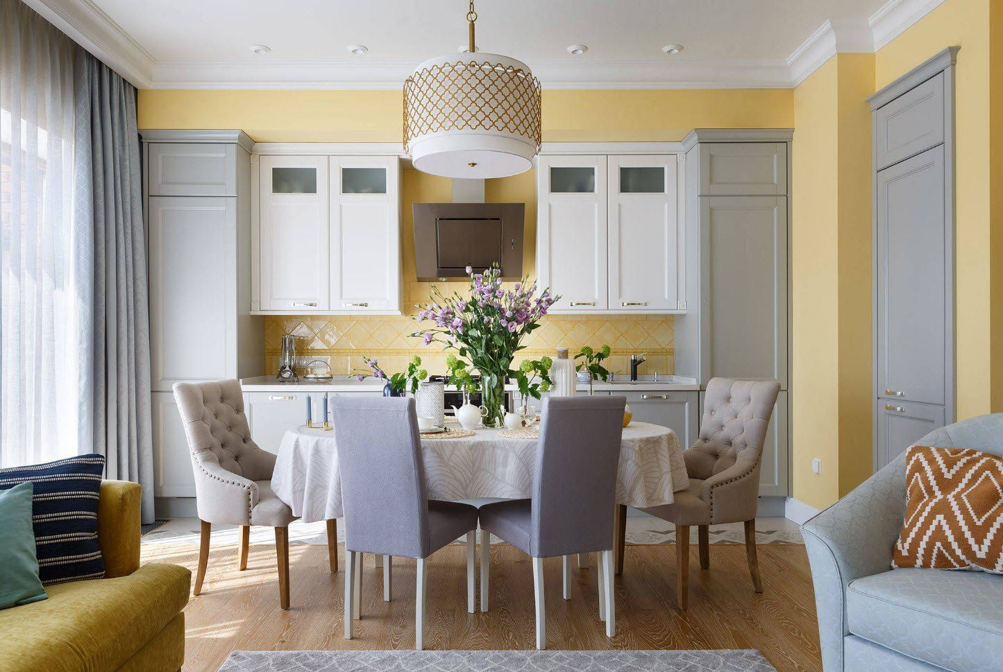 White Classic kitchen cabinets combined with yellow walls