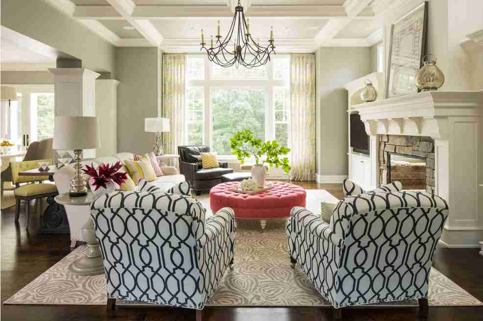 Ivory Interior Decoration Ideas, Photos, Advice. Forged black chandelier as an accent in Classic designed living with red round coffee table