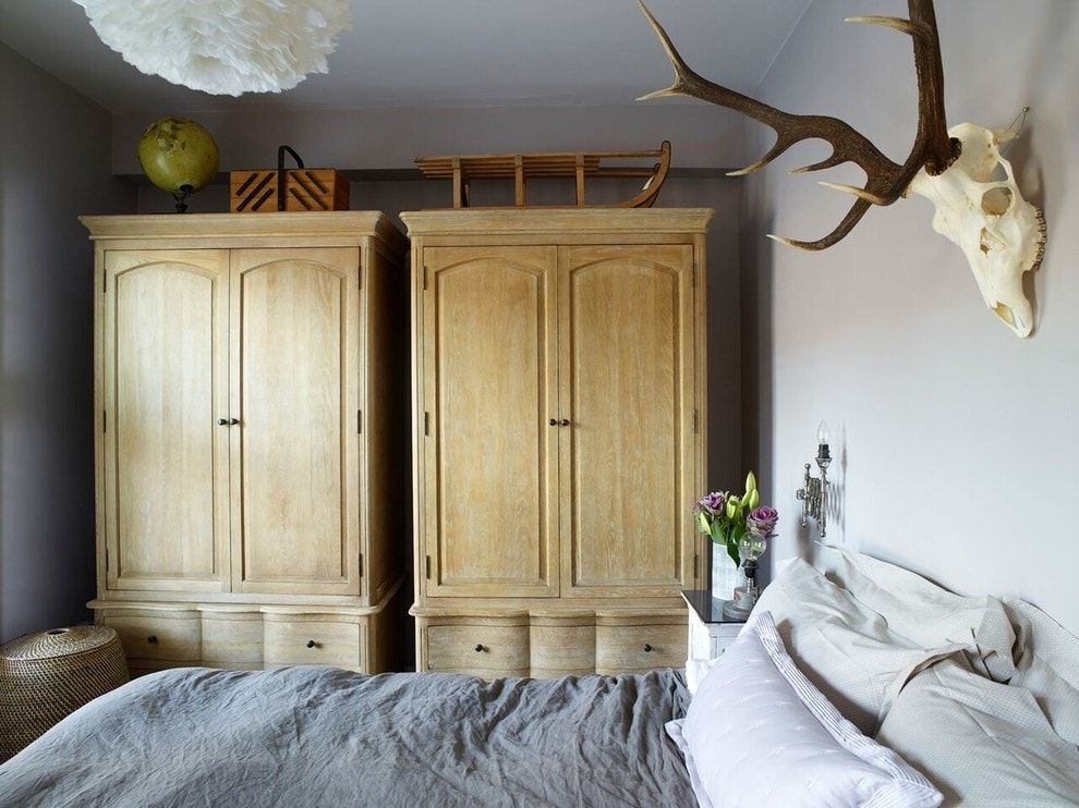 Classic designed bedroom with light wooden cabinets
