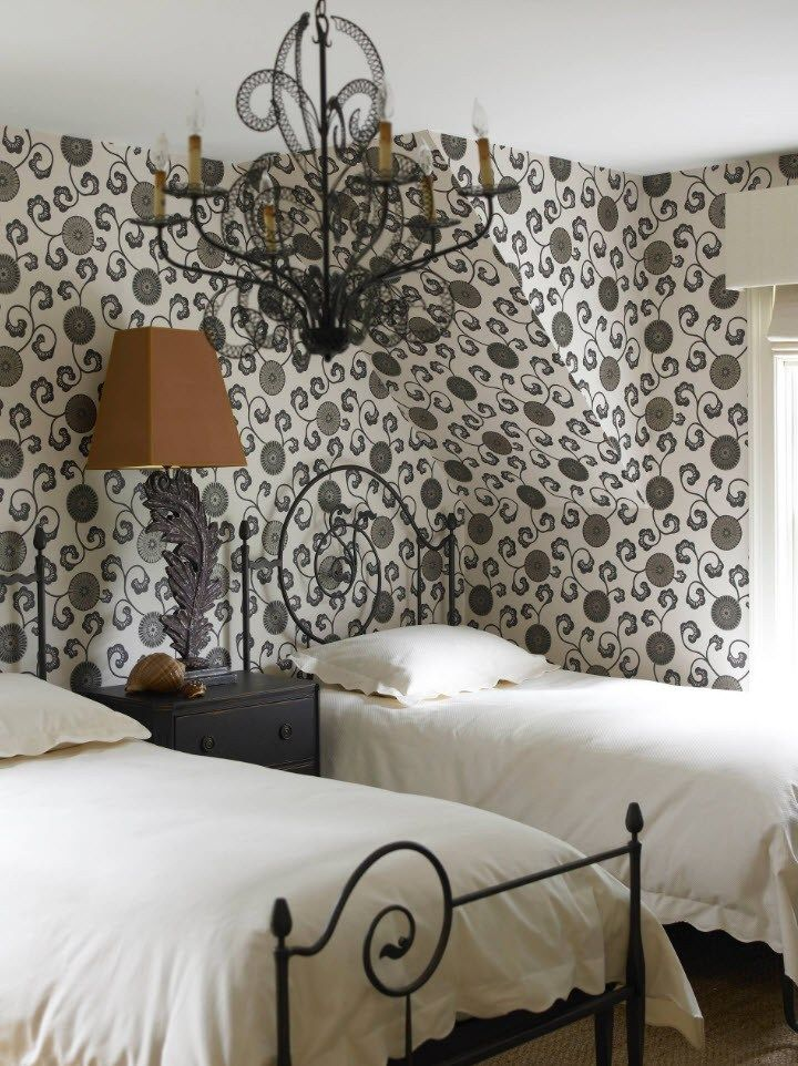 Black and White Wallpaper: Ageless Classics in any Interior. Thin black metal frames of beds in the bedroom for two