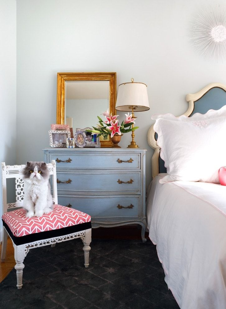 Classic girl's bedroom interior with blue bedside table