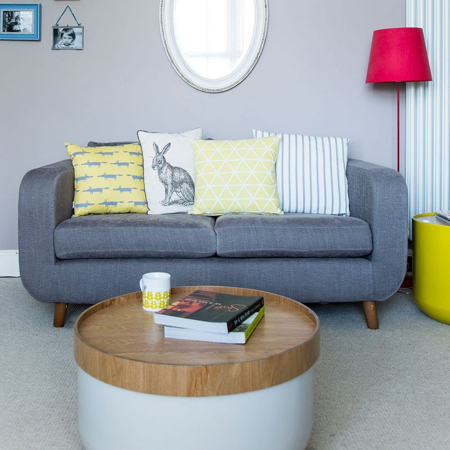 130 Square Feet Living Room most Effective Design Ideas. Round coffee table and gray upholstered sofa