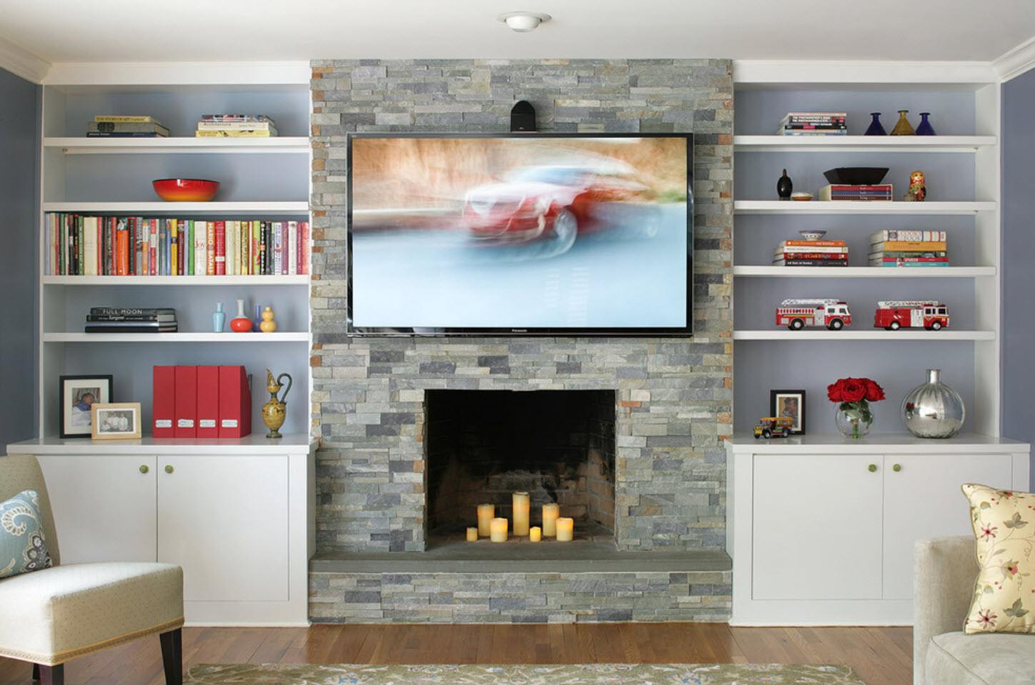 Aritificial stone trimmed accent wall with shelves on both sides