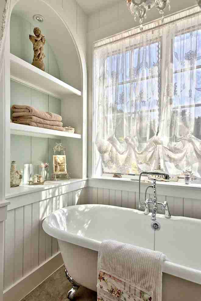 Classic interior of the bathroom with tulle curtains