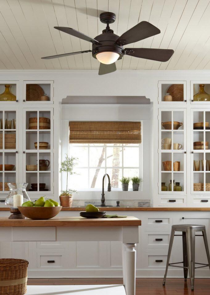 120 Square Feet Kitchen Interior Design Ideas with Photos. White facades of the kitchen set with sash windows