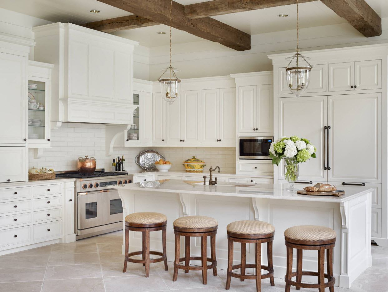 Open ceiling beams and chairs in dark oak color and white classic kitchen facades