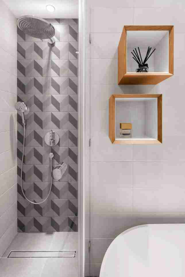 Unusual herringbone tile and wooden shelves to revive gray colored bathroom