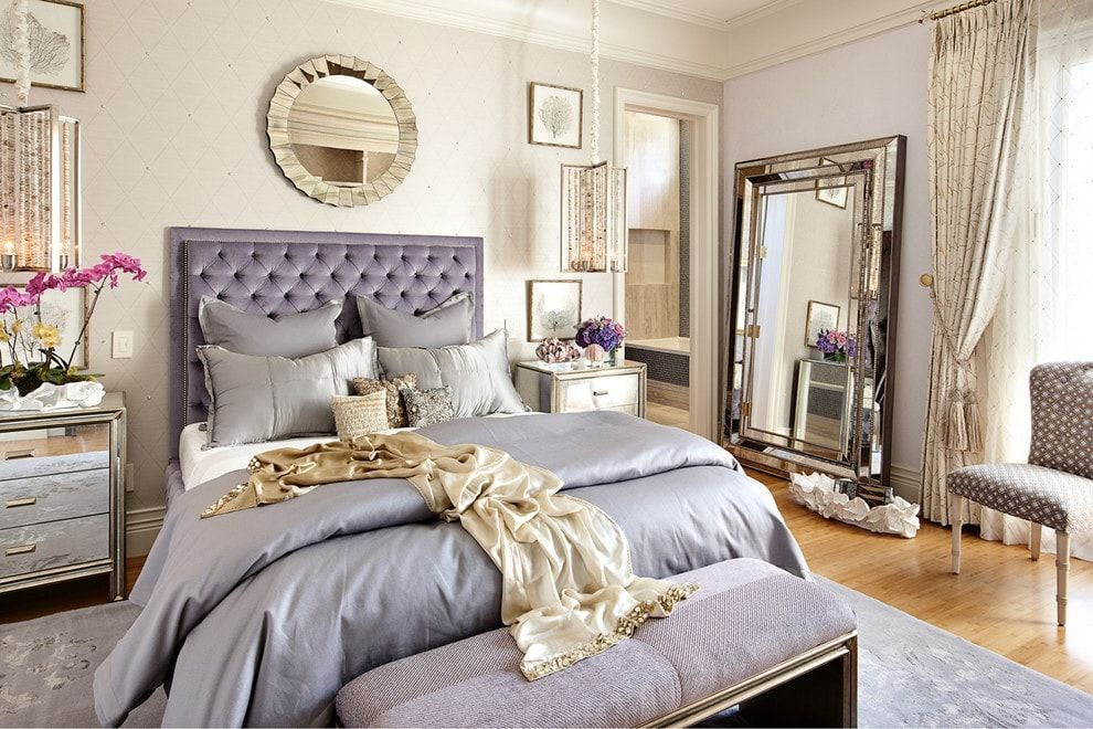 Purple quilted headboard and silver bedding