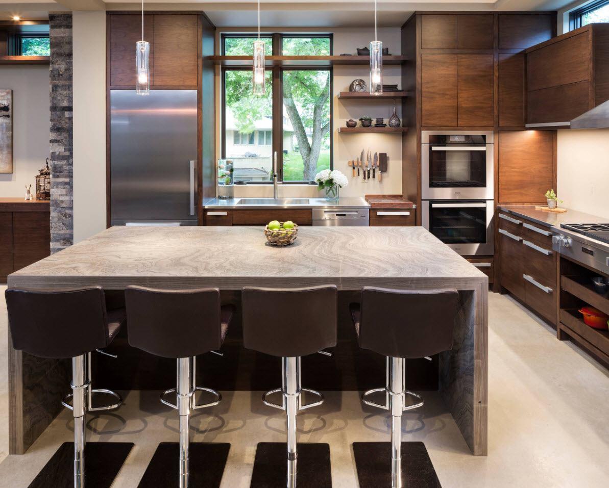 Dark designed kitchen with dark swivel bar stools