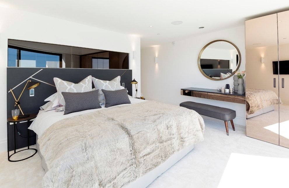 150 Square Feet Bedroom Interior Decoration and Photos. Gray inlays in the spacious bedroom with round mirror