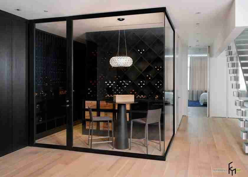Gorgeous wine storage at the zoned box with black frames and dark walls