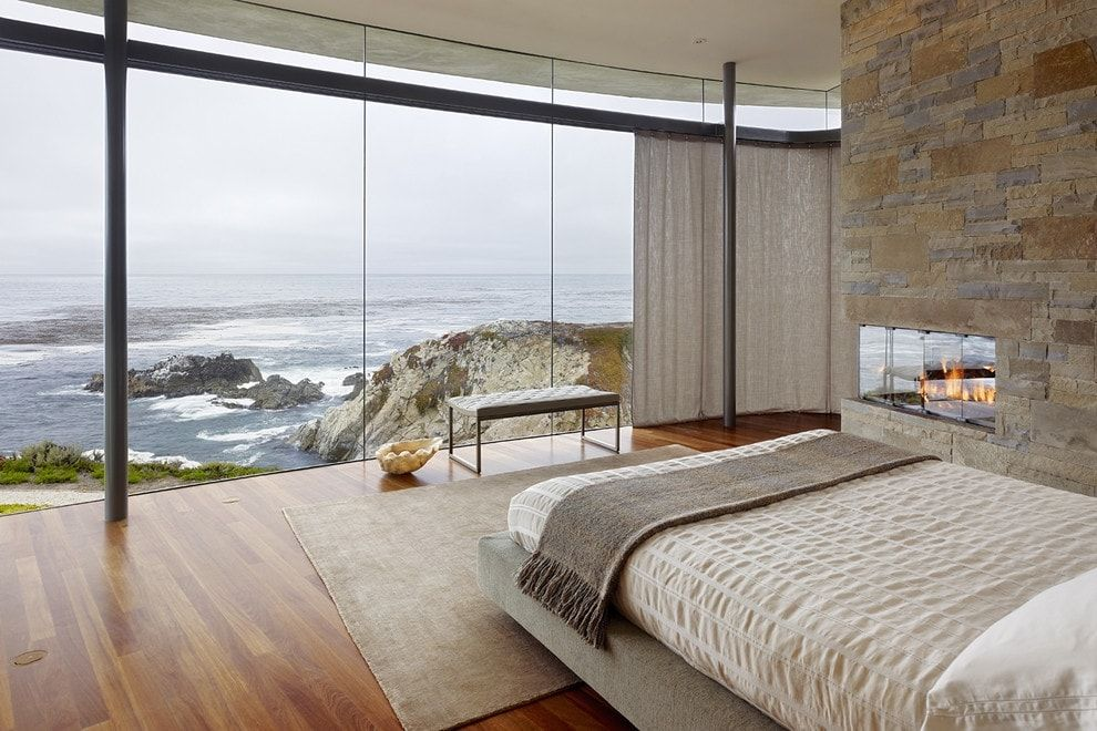 150 Square Feet Bedroom Interior Decoration and Photos. Panoramic window at the oceanside apartment