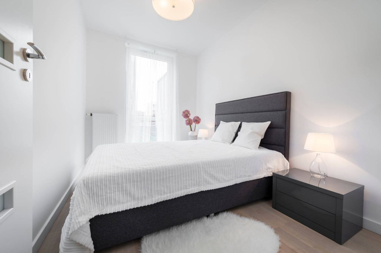 White designed neutral designed bedroom with black bed