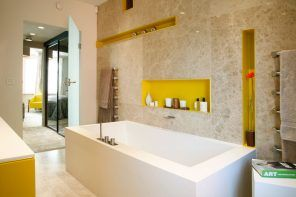 Niche in the Room: Recess in the Wall for Decoration and Functionality. Yellow inlays in the modern bathroom for different trifles