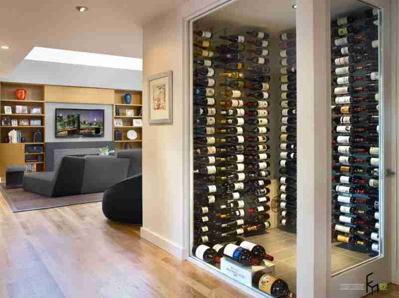 Open space for the wine storage in the modern designed light interior