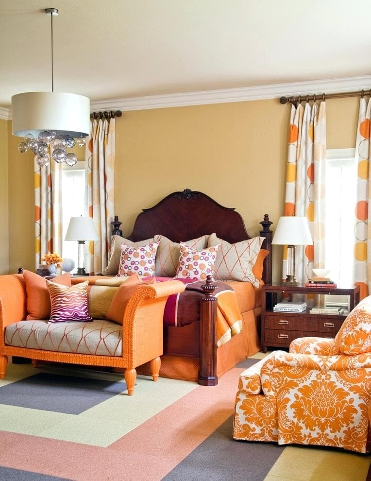 150 Square Feet Bedroom Interior Decoration and Photos. Orange cheerful design of the Classic styled room with dotted curtains