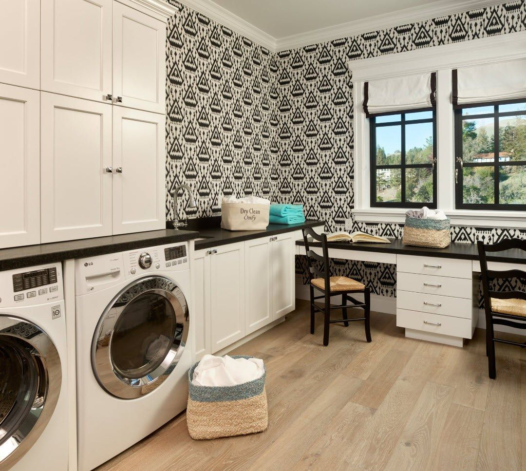 Laundry and home office combined with casement window and black and white wallpaper