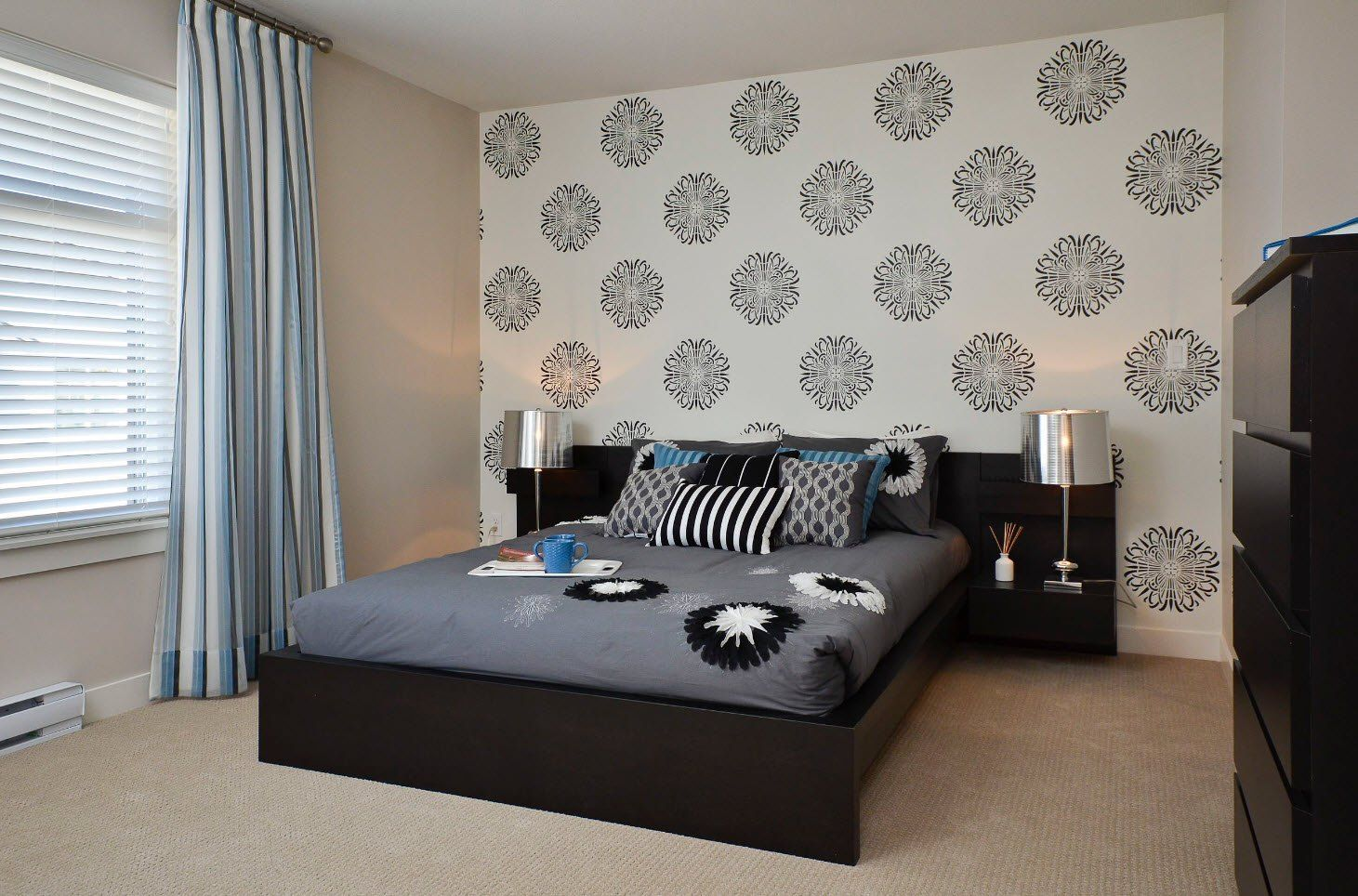 Black and White Wallpaper: Ageless Classics in any Interior. Simple design of the bedroom with dark bed and print on the accent wall