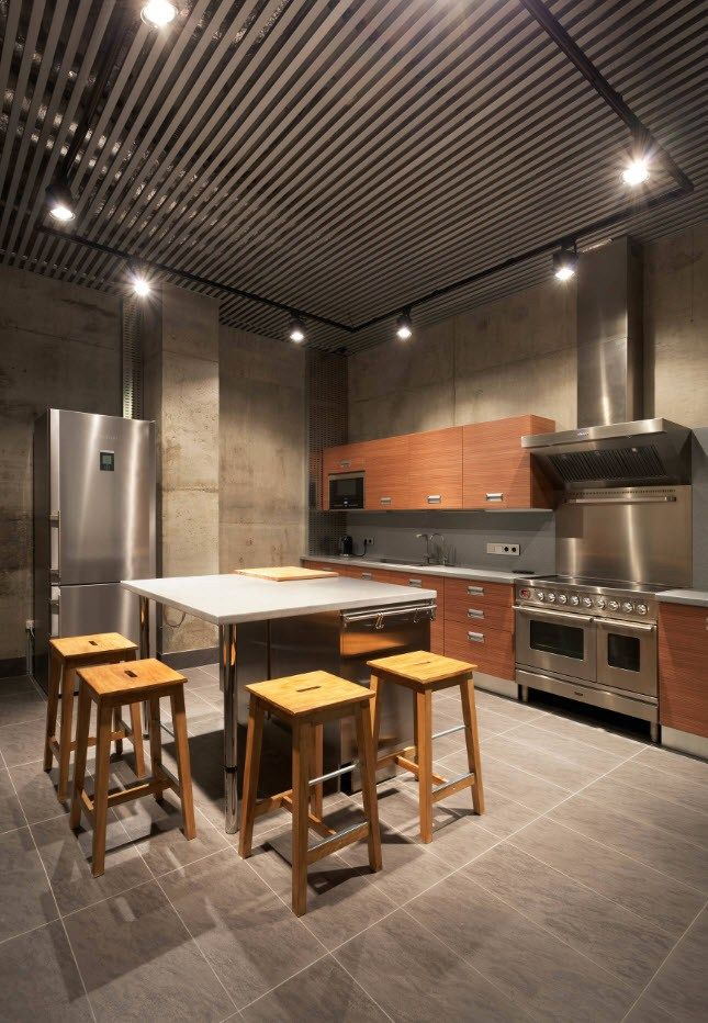 Loft design with steel gray color theme, concrete walls and latticed ceiling