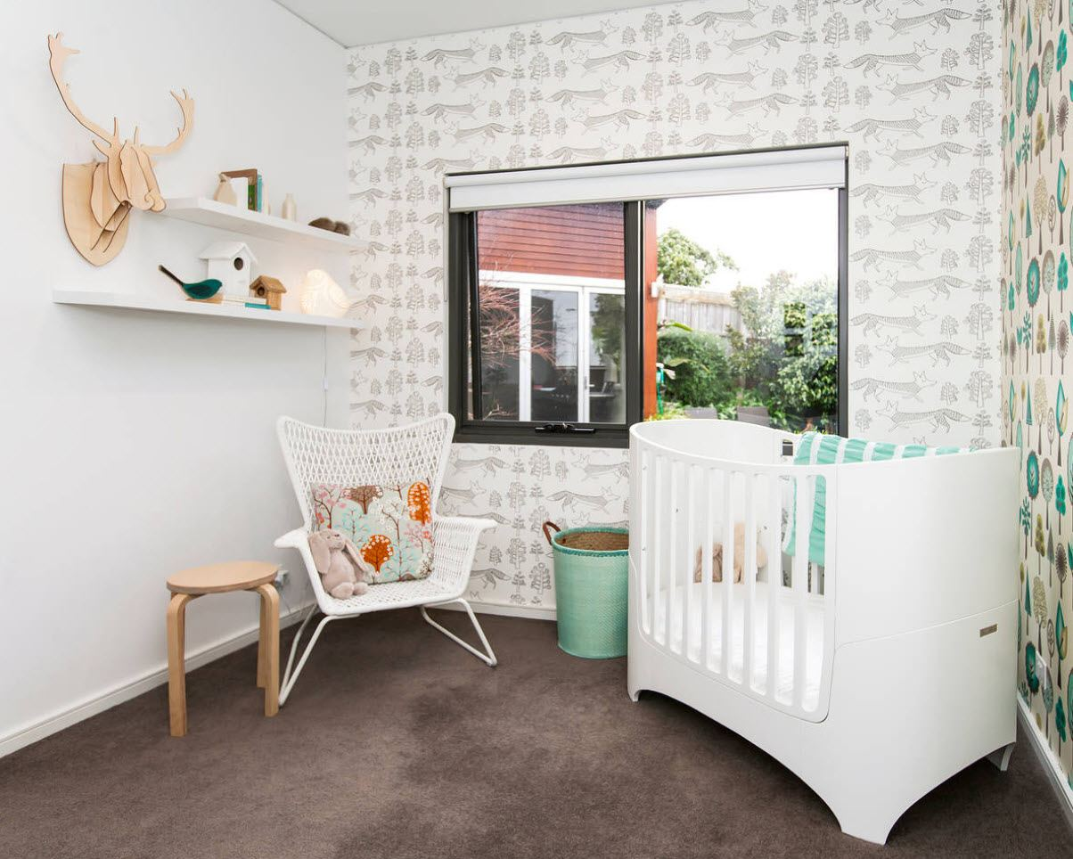 Gray pattern of the wallpaper and black window frame in the nursery