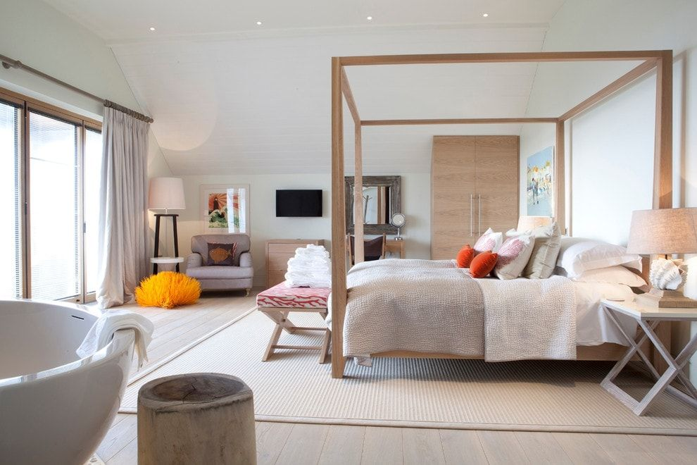 Canopy bed in the spacious bedroom with white pianted walls