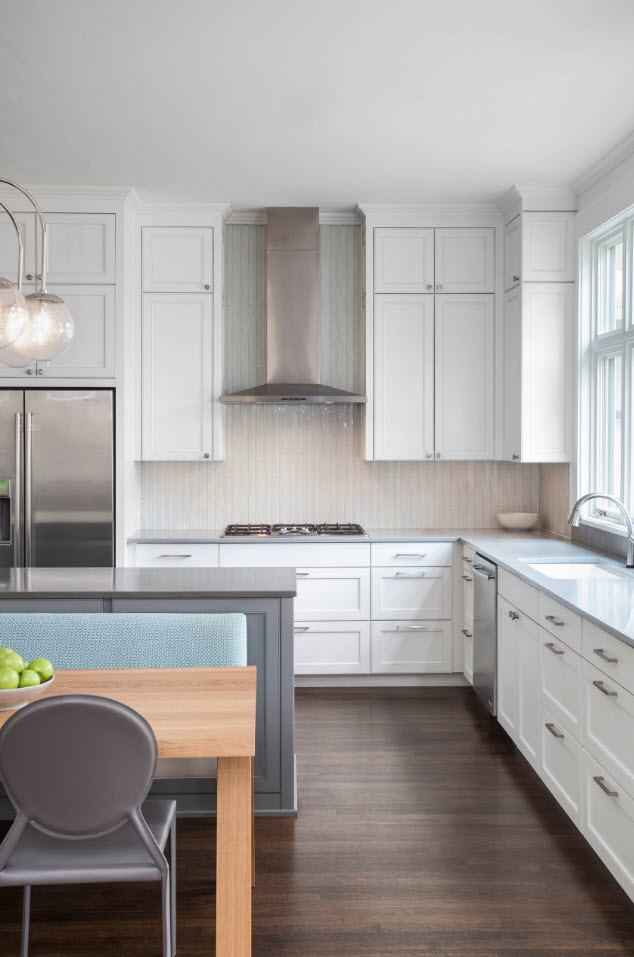 Carved white cabinets' facades for classci styled kitchen in white