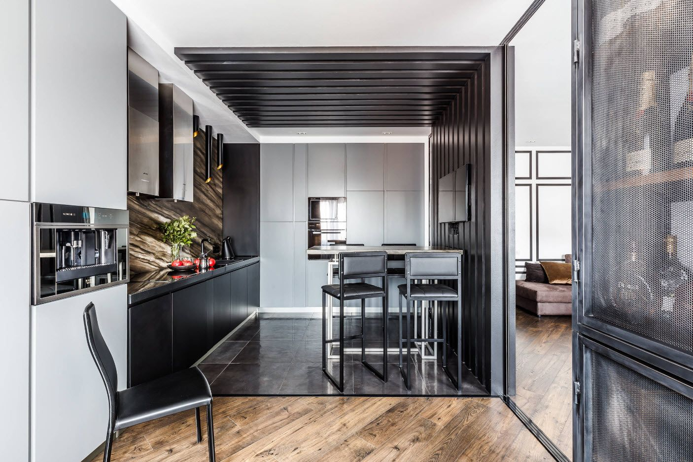 Steel gray kitchen zone with dining table and high stools
