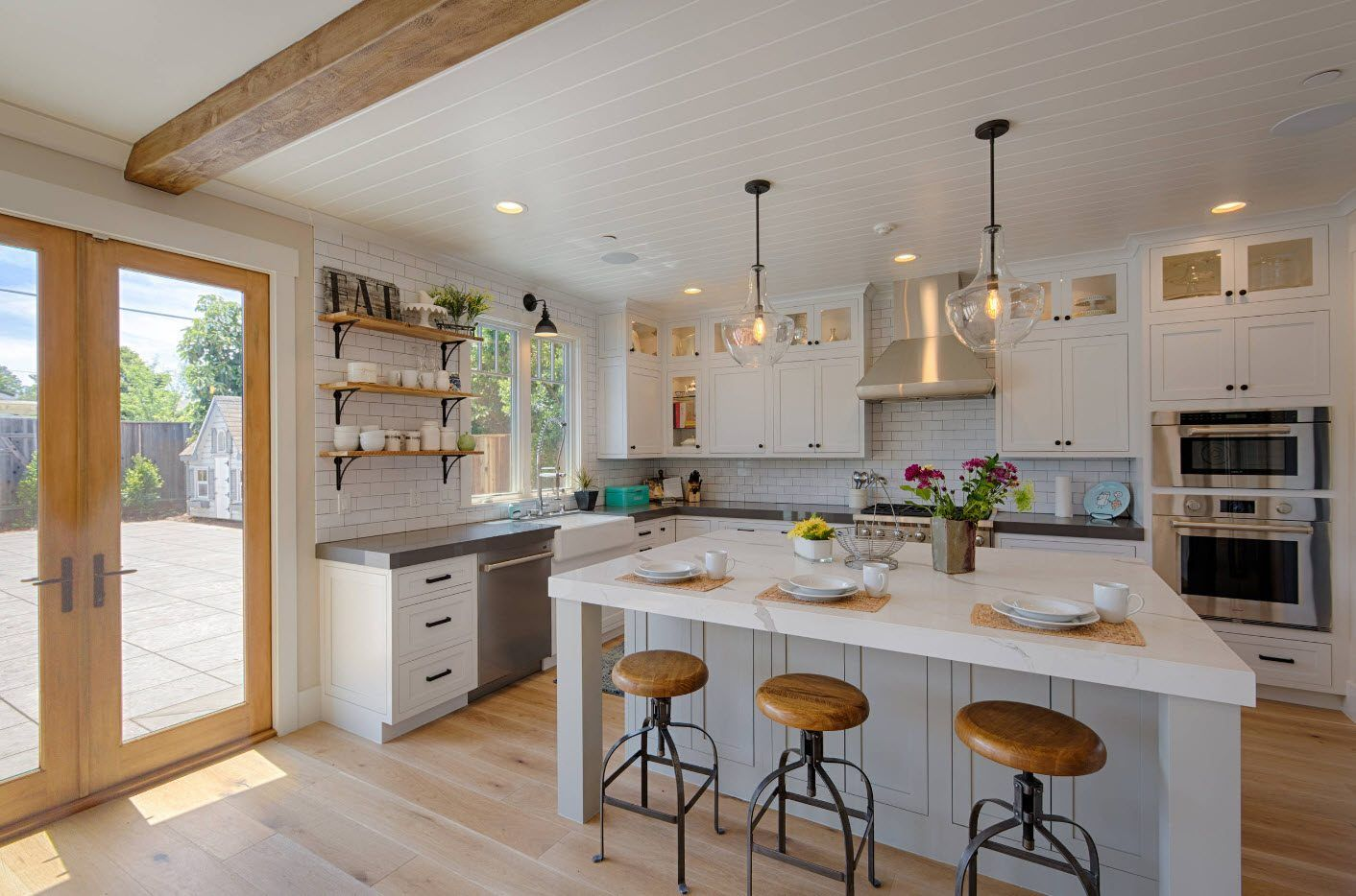 160 Square Feet Kitchen Design Ideas. Classic designed kitchen with open wooden ceiling beam and car stools