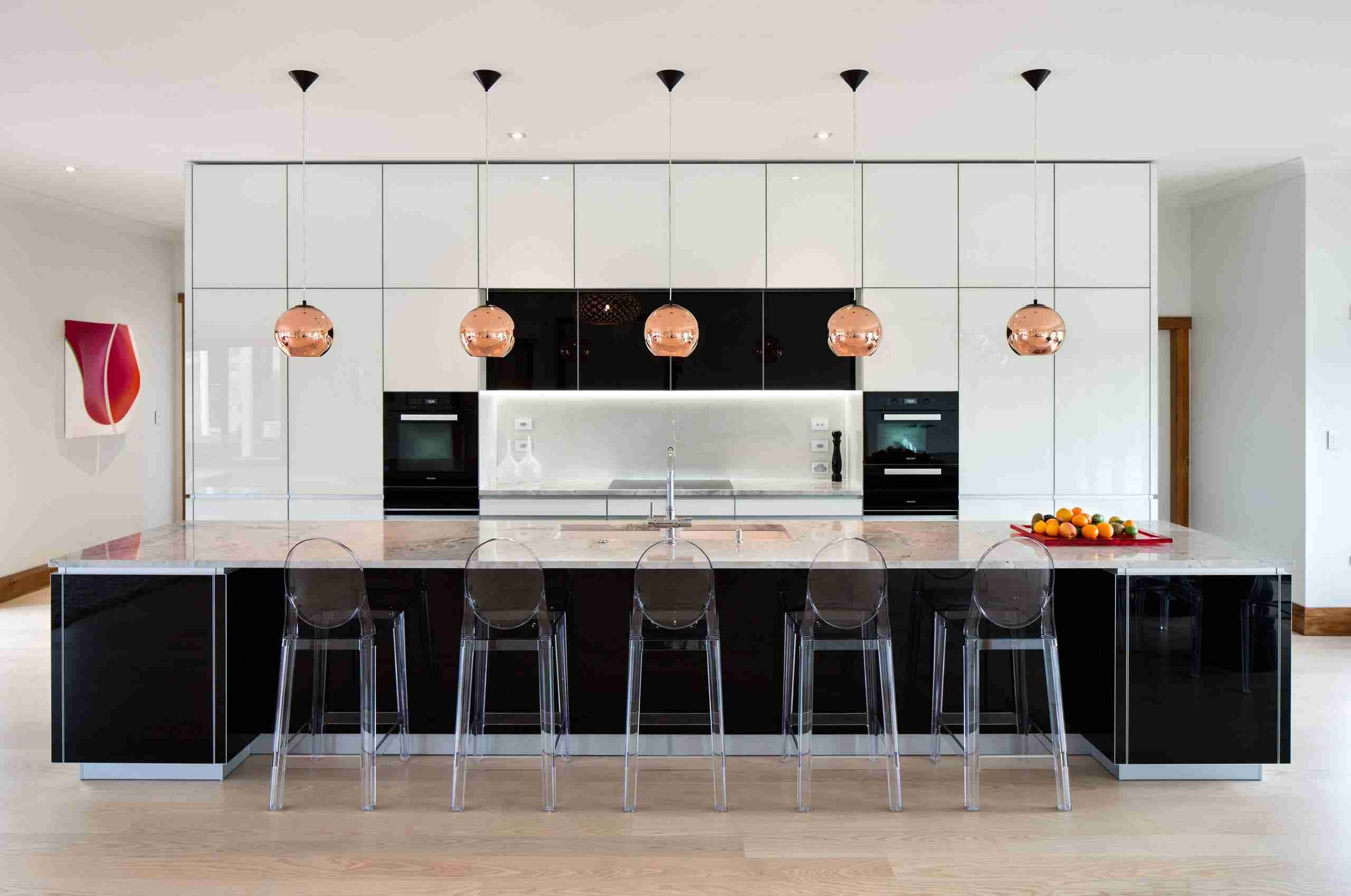Solid Wood Kitchen Stylish Ideas for Modern Interiors. Black and white kitchen design with plexiglass chairs at the island